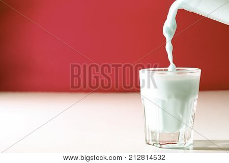 a glass of milk as a background / Milk is a white liquid produced by the mammary glands of mammals