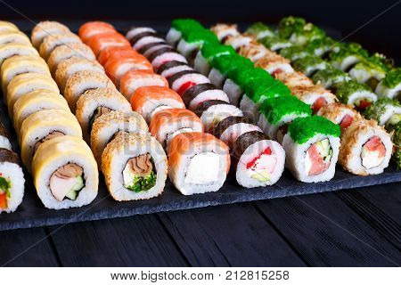 Great Assortment Of Tasty Multicolored Maki Sushi Rolls, Selective Focus. Sushi Restaurant Concept