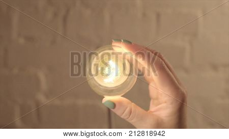 Hand Turning Off The Bulb Lamp.turning Off The Light. Male Hand Turn On A Light Bulb. New Idea Conce