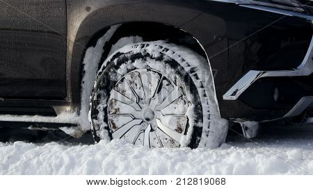 Off road truck wheel in the snow close up stock photo