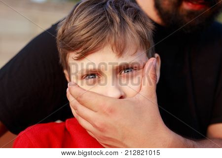 Kidnapping. Unknown Man Covering Scared Child Face With Hand. Child Abuse, Violence Concept
