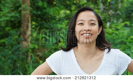 Asian Woman Long Hair With Facial Epression Green Nature Background
