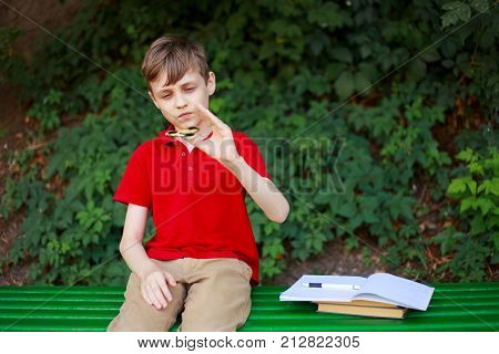 Schoolboy Playing With Fidget Spinner Instead Of Doing Home Task. Education, Concentration, Reducing