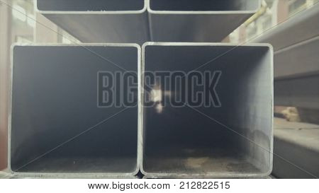 Metal Pipe Profile And Sun In The Background. Sheet Metal Profiles Transporting, Close Up. Metal Or