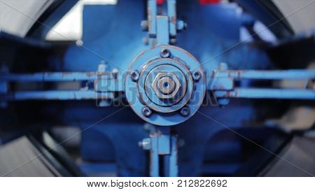 Big bolt. The rotating part of the machine. View of rotation machine in Printing house. Part of machine that is called the star, it changes rolls of paper continuously. manufacturing equipment HD