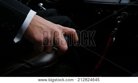 Businessman Driving To Work, Hand Shifting The Gear Stick. Businessman Shifts The Transmission In Th