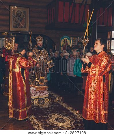 Adygea Russia - November 8 2017: a festive liturgy in an Orthodox church with the participation of the Archbishop Archdeacon and Subdeacon