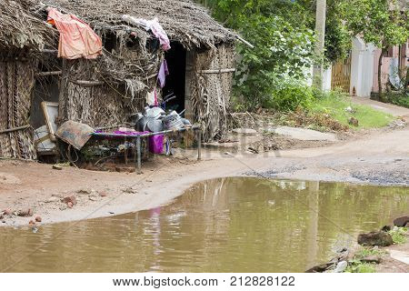 Flood flooding flooded road street after rain house poor India