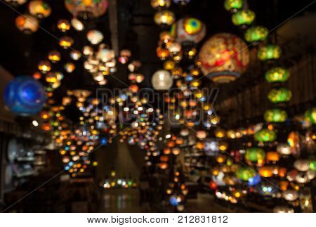 Blurred multicolored oriental lamps hanged from the ceiling/ Blurred Lighted glass tile lamps hanged / Blurred Colored mosaic lamps hanging from ceiling