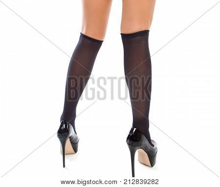 Close-up of beautiful sexy legs in black stockings. Isolated on a white background