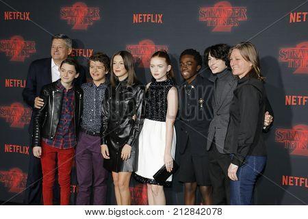 Ted Sarandos, Noah Schnapp, Gaten Matarazzo, Millie Bobby Brown, Sadie Sink, Caleb McLaughlin and Finn Wolfhard at the Netflix's season 2 premiere of 'Stranger Things' held in USA on October 26, 2017.