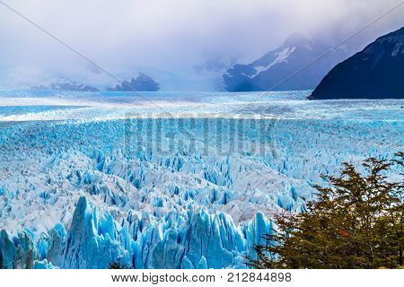 The spectacular glacier Perito Moreno, located in the national park of Los Glaciares in the Argentine part of Patagonia. The concept of ecological and extreme tourism