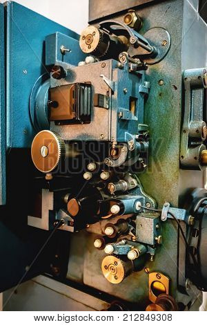 Old cinematographic machinery. Analogue film manufacturing. Movie industry.
