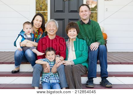 Multi-generation Chinese and Caucasian Family Portrait