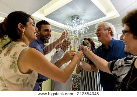 Family holding glasses of champagne making a toast for the new year coming