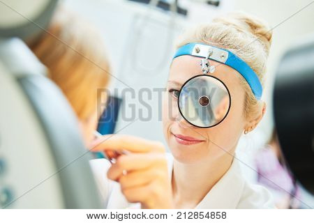 female doctor of ENT ear nose throat at work