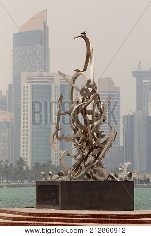 DOHA, QATAR - JULY 15, 2017: A calligraphic art installation on the Corniche, created by artist Sabah Arbilli, for National Day. The Arabic letters spell out a poem by Qatar's founding father.