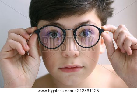 Teenager Kid Boy In Myopia Correction Glasses