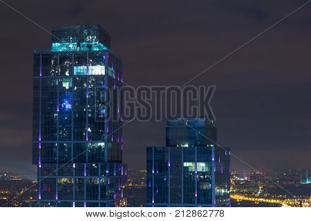 MOSCOW - DEC 15, 2013: Top of buildings in Moscow International Business Center at night. Years of construction of complex - 1995-2018
