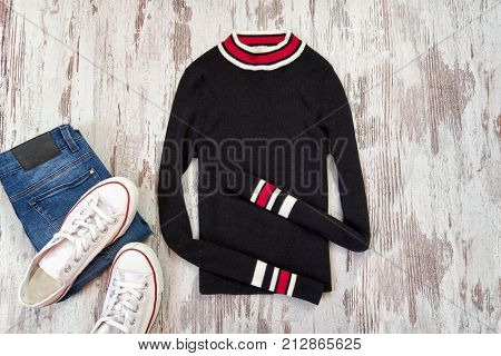 Black Sweater, Jeans And White Sneakers. Fashionable Concept