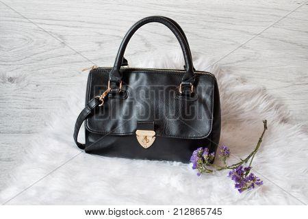 Black Female Bag On White Fur. Fashionable Concept