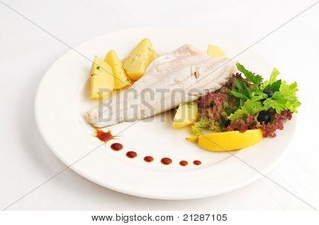 Steam pike perch with a garnish