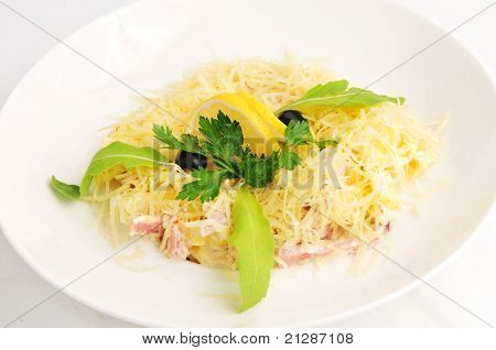 Macaroni baked with fish on a white plate poster