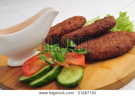 The fried cutlets with sauce