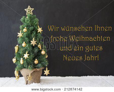 German Text Wir Wuenschen Ihnen Frohe Weihnachten Und ein Gutes Neues Jahr Means We Wish You A Merry Christmas And A Happy New Year. Tree With Black Cement Background. Modern Urban Style With Snow