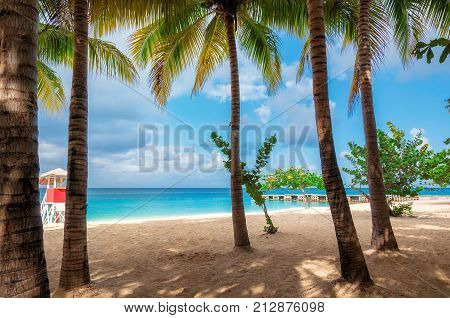 Caribbean  beach with turquoise sea in Montego Bay, Jamaica.