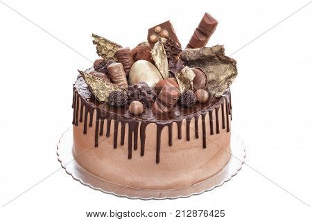 Chocolate cake with chocolates on the day of birth. On a white background.
