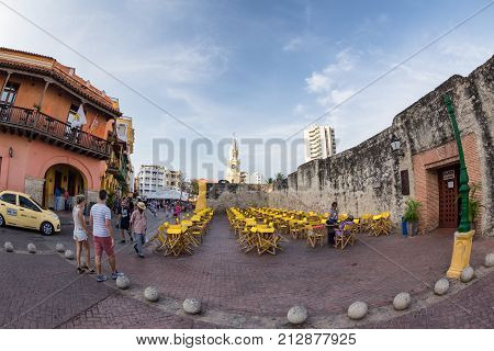 CARTAGENA COLOMBIA - MAY 22: Unidentified tourists walk past the plaza de los Coches in Cartagena Colombia on May 22 2016.
