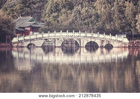 Retro Toned Picture Of Suocui Bridge, Lijiang, China.
