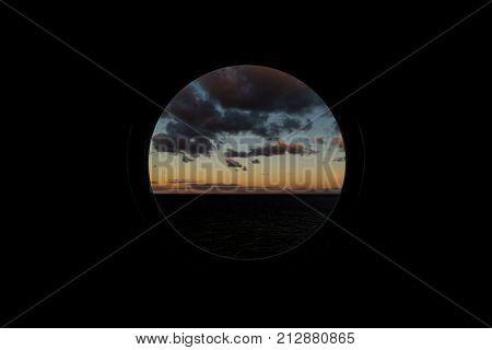 View Through Round Porthole Scuttle On Dawn At Sea