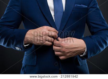 Close-up Man Adjusting His  Jacket Button