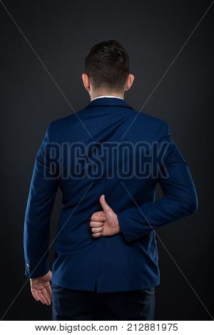 Back Of Businessman Holding Hand Behind With Thumbup