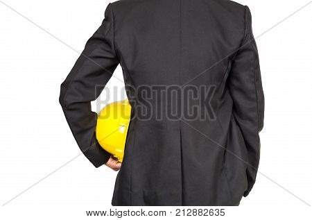 engineer in suit holding yellow helmet for workers security on white background include clipping path industrial concept