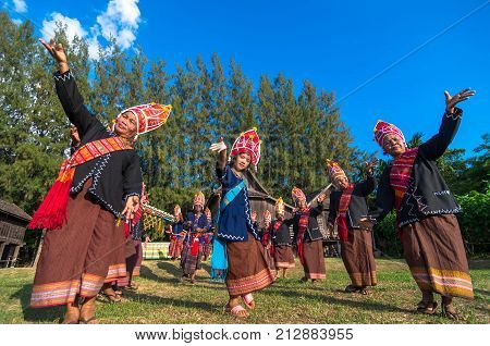 NAKHON RATCHASIMA THAILAND - OCTOBER 30: Undefiend traditional people with Ancient rocket with cart on parades showing in Rocket festival on October 30 2015 in Nakhon ratchasima Thailand.