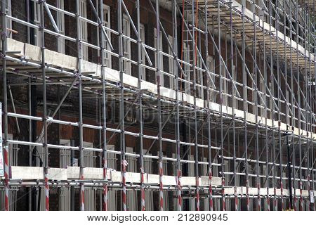 Scaffolding on a building undergoing construction work.
