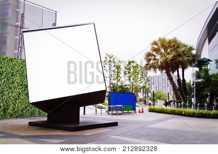cube shaped blank showcase billboard or advertising light box for your text message or media content at open air shopping center advertisement commercial and marketing concept
