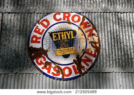 DOWNER, Minnesota,October 3, 2017:  The rusty old Red Crown tin sign advertises Red Crown Gasoline once a product of Standard Oil Company formed in 1889 by John D. Rockefeller as part of the Standard Oil trust.