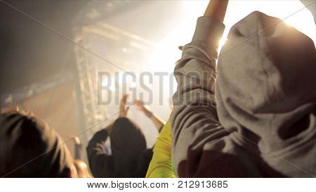 Back view of crowd of people at the concert. Silhouettes of concert crowd in front of bright stage lights. Cheering crowd at a rock concert HD