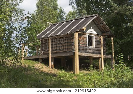 Siberian village council, Verkhovazhsky District, Vologda Region, Russia - August 6, 2015: Hut of Baba Yaga in the territory of the natural monument