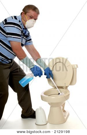 Man in protective mask and gloves cleaning a domestic toilet. poster