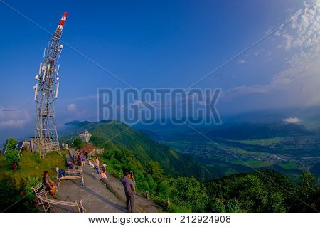 POKHARA, NEPAL, SEPTEMBER 04, 2017: Unidentified tourist at hilltop of the Sarangkot lookout point in the mountain to view Annapurna Range during sunrise at Sarangkot, Nepal.