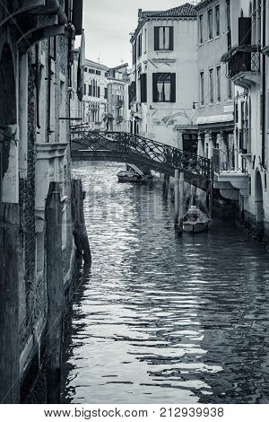 Canal in Venice, Italy. Venice cityscape, narrow water canal and traditional buildings. Italy, Europe. Italy beauty, silence on typical canal street in Venice, Venezia. Black and White photo.