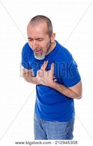 A man touches his chest with a painful face