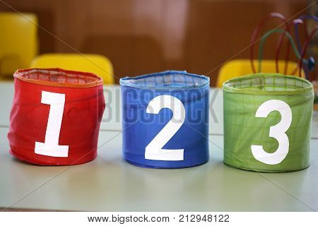 Colorful Jars With Drawn Numbers 1 2 3 On The School Table