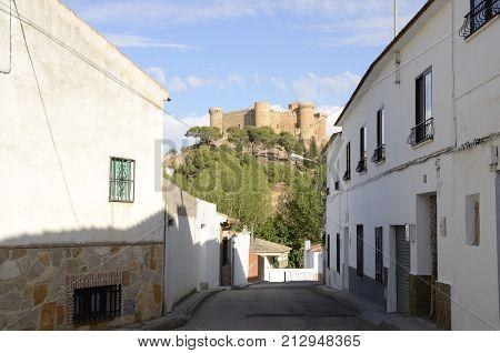 BELMONTE, SPAIN -JULY 29, 2017: Sight of the castle from street of Belmonte village province of Cuenca Spain.
