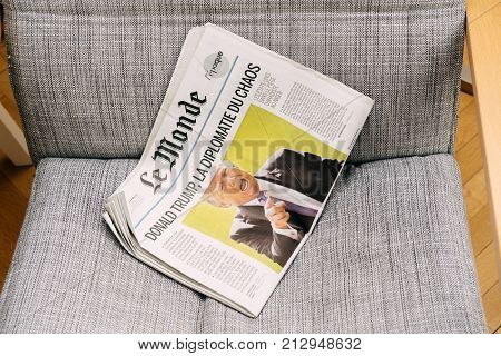 PARIS FRANCE - NOV 6 2017: Armchair background latest Le Monde newspaper featuring headline Donald Trump is Chaos Diplomacy